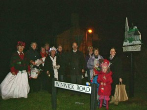 A troop of singers all decorated in tinsel and fairy lights went around the village singing christmas carols