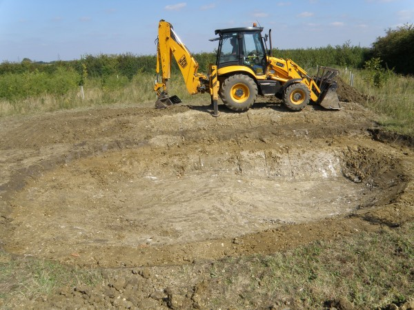 Shaping the spoil heaps - Great Gidding Jubilee Wood pond excavation. Photo: Michael Trolove