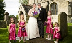 Laura and Mads with their bridesmaids in front of St Michael's Curch, Great Gidding