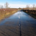 Flood water passing over the B660
