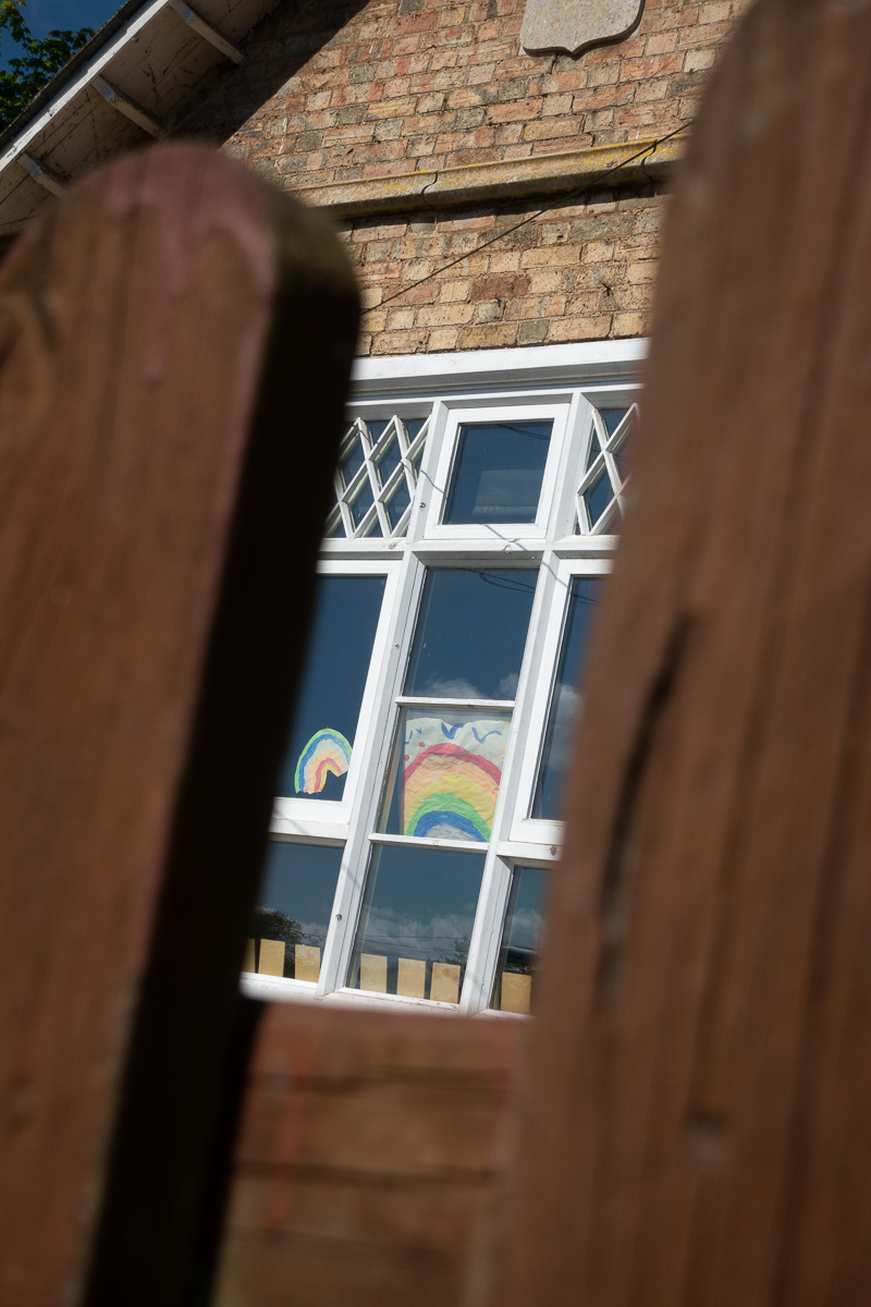 Rainbow 'Stay Safe' posters in window during Covid-19 lockdown at Great Gidding School