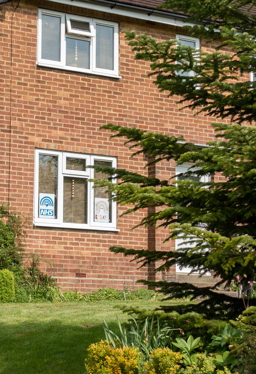 NHS signs in window on Chapel End